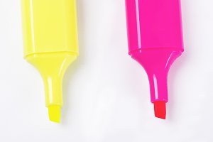 Yellow and pink highlight pen on white background. Isolated.