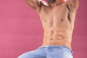 shirtless abs man posing pink fit