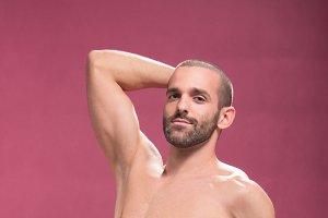 handsome shirtless man pink muscular