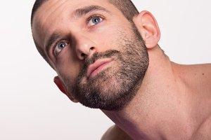 man looking above shirtless closeup