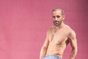 man posing shirtless abs muscular