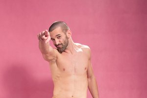 man jump air pink background