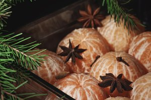 Fresh tangerine with spices on dark background, christmas concept