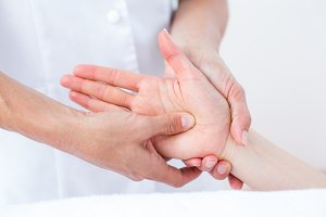 Physiotherapist doing hand massage