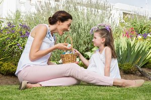 Mother and daughter collecting easter eggs
