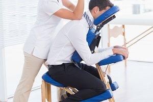 Businessman having back massage