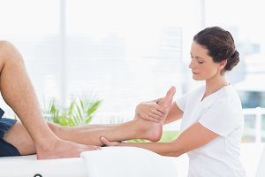 Physiotherapist doing leg massage