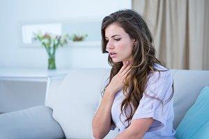 Pretty woman doing asthma crisis