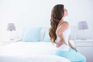 Attractive woman with back pain