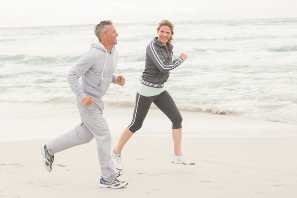 Fit couple jogging together