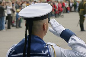 Soldier saluting at military parade