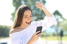 beautiful girl receiving a sms