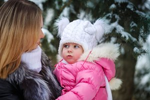 Mother and daughter talk. Winter