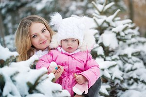 Mother and daughter portrait. Winter