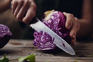 Woman cutting cabbage