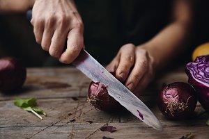 Chef cutting onion