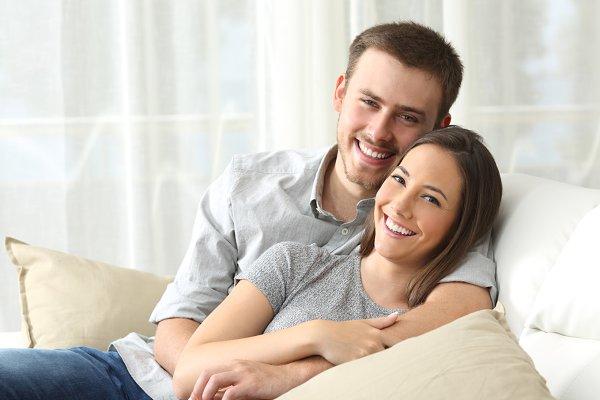 Happy couple sitting
