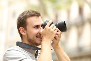 happy man photographing