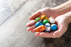 Hands showing Easter eggs