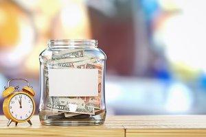 Money is in a glass bottle.