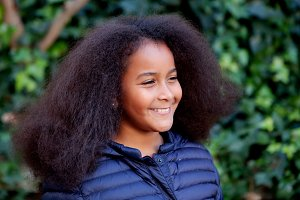 Happy girl with afro hair outside
