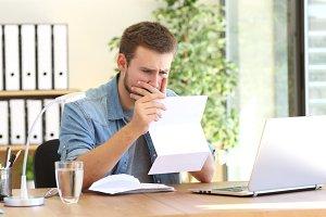 Worried entrepreneur working