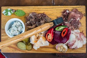 Meat, lard, vegetables on board