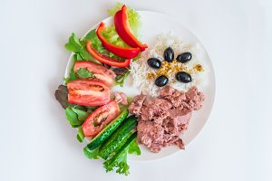 rice, tuna chopped vegetables, olives
