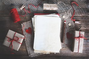 Sewing set: fabrics, threads, pins, buttons, tape and handmade hearts on burlap, sackcloth background. Toned effects.