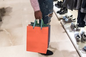 woman shopping with bags in a mall