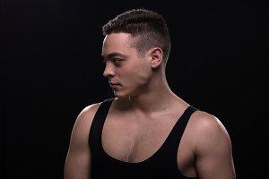 man posing sideways broad shoulders