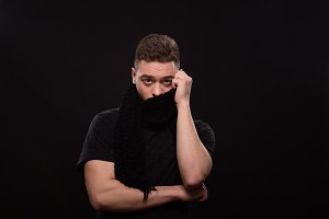 man hiding behind scarf head face