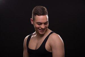 Man smiling upper body muscular