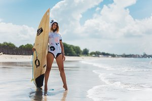 girl with a surf board
