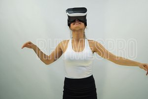 Girl Wearing VR Headset on a White Background