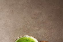 Homemade pea soup with bread. Dark background.