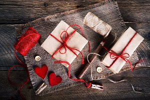 Vintage gift boxes with blank gift tag on old wooden background.