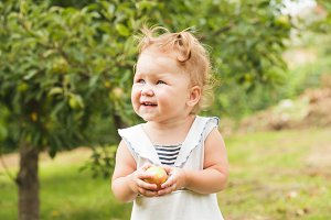 Baby girl under the apple tree