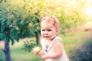 Baby girl under the apple tree