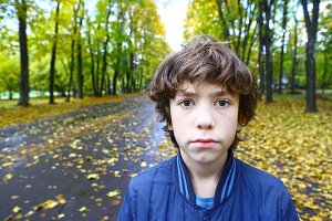 boy close up outdoor sad unhappy portrait