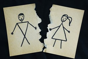 man and woman drawing torn apart