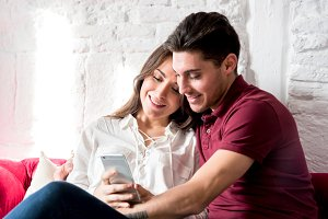 happy young couple with mobile phone