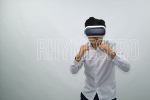 Man Fights in Virtual Reality Glasses on a White Background