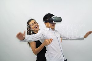 Man and Young Girl Uses a Virtual Reality Glasses on a White Background