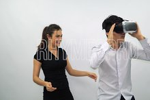 Boy and Young Girl Wearing VR Headset on a White Background