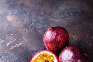 Passion fruits on dark table