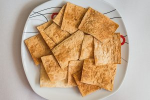pita chips in white plate