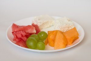 sliced watermelon, cantaloupe, cheese, grapes