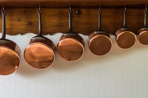 saucepans hanging in the kitchen