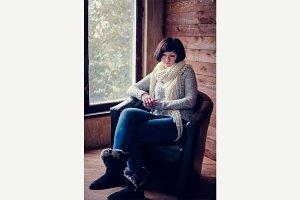 Beautiful woman sitting in an armchair